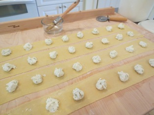 Ricotta filling placed on strips of pasta dough