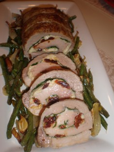 Pork Loin Stuffed with Spinach, Fontina, Parmesan Cheese, and Sun Dried Tomatoes