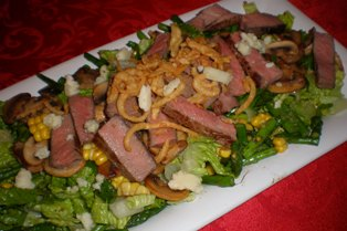 Grilled Steak Saladwith Crispy Onion Rings
